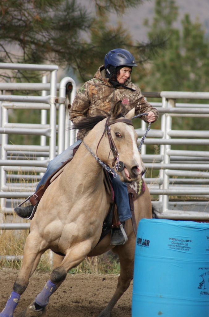 Amanda running barrels on Louie.